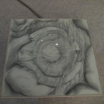 Carita Savolainen, Source, pencil on paper / class / sound trac (loop) underneath, 110cm x 110cm) 2012